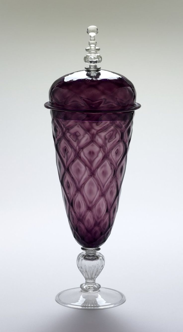 Goblet with cover; glass; tall purple bowl with moulded diamond ribbing on short vertically ribbed clear glass baluster stem and folded bell-foot; cover dome-shaped with fainter diamond moulding made of purple glass, surmounted by tall clear glass knop. Italy (Venice), late 16th century.