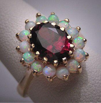 Vintage Australian Opal Garnet Ring Victorian Wedding by AawsombleiJewelry on Etsy https://www.etsy.com/listing/183932942/vintage-australian-opal-garnet-ring