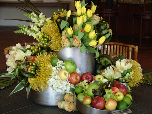 Fun Centerpiece: LOTS of fruit and tropical flowers, put inside cookware / dutch oven pots