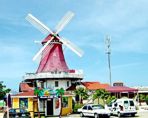Windmill Oranjestad, Aruba. According to records , human beings first reached Aruba some 4,500 years ago.