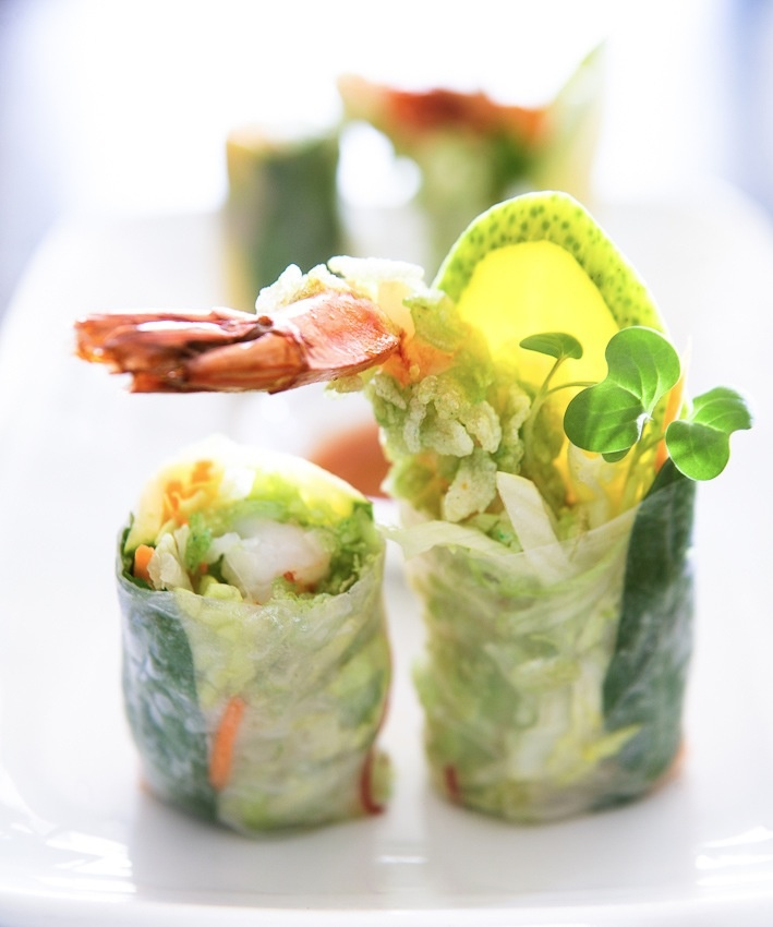 Rice paper roll with prawn tails fried in green rice & green mango.  These are Amazing