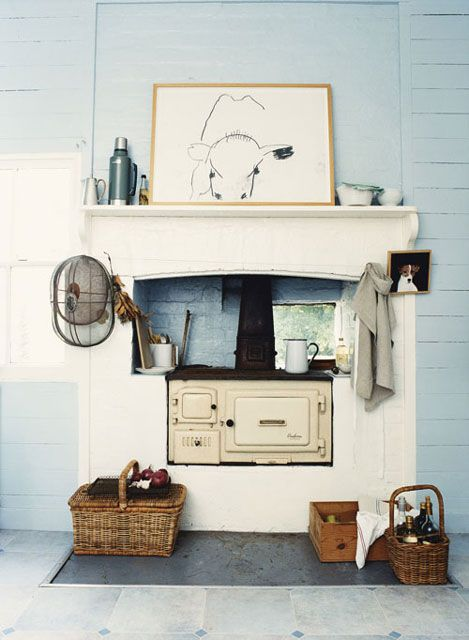 a little wood burning cook stove in an old fireplace | interior design + decorating ideas