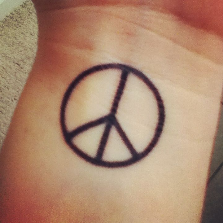 Peace sign tattoo, just looking for placement