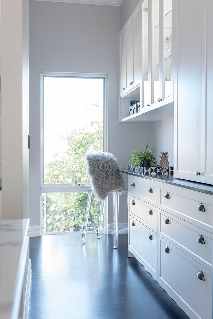 Stunning Classic Luxe Renovation of a 1940's Workers Cottage located in WA's South West. Completed by Colourcube Interiors. Scullery area located in Scullery / Kitchen. Ghost Chair. Stained Timber Floors. Shaker Cabinet Doors