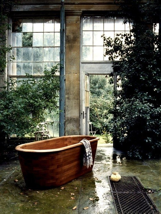 Warm wooden tub in a rustic room. Eerily romantic...