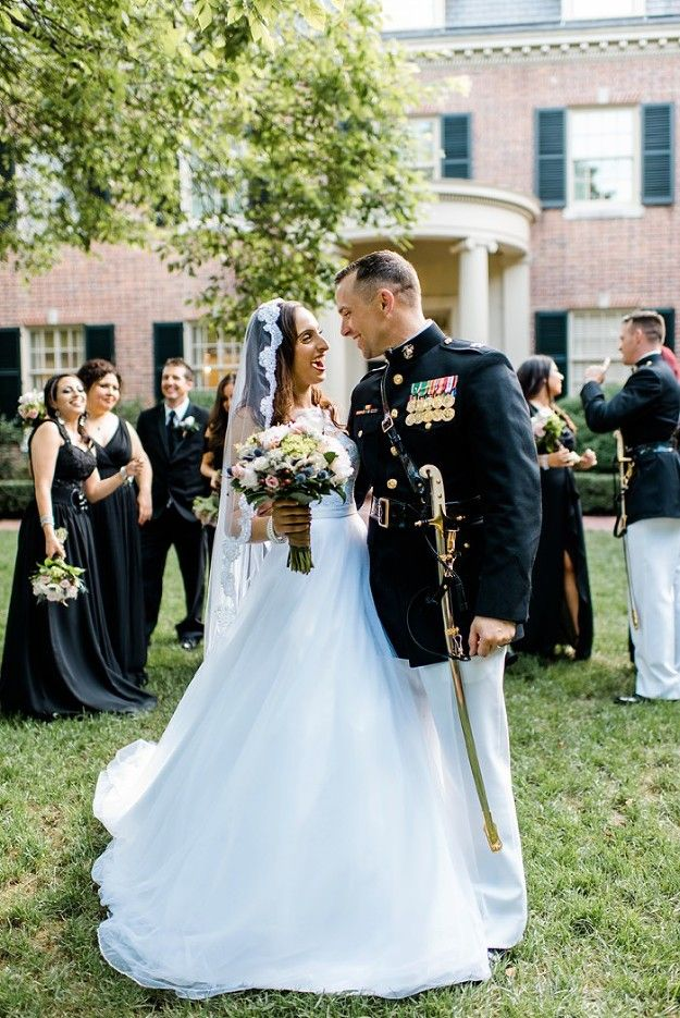 Multicultural military wedding at the Carolina Inn in Chapel Hill. Long black bridesmaids dresses.