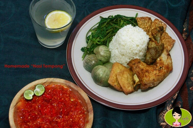 Sego Tempong / Nasi Tempong : Typical food from Banyuwangi - East Java. Very popular for its super hot condiment. Usually serves with boiled vegetables such as cucumber, eggplant, kale, squash and also fried soybean curd or soybean cake