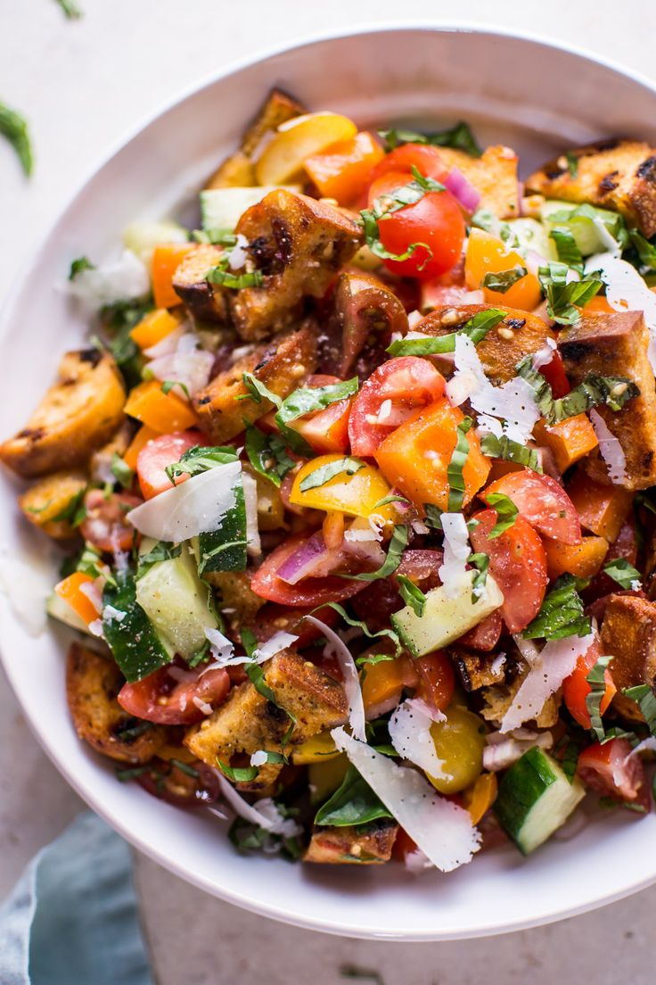 Panzanella is a classic vegetarian tomato and bread salad that's fresh, flavorful, colorful, and makes a healthy meal or side salad.