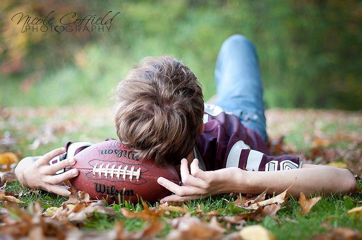 senior boy pose with football
