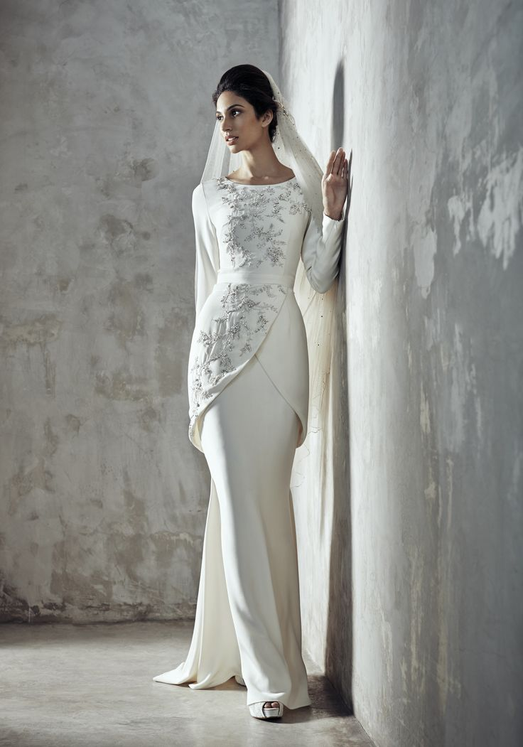 Photographer: Gerald Goh from Imagerom Studio Code: MLC-B14-20042-IVY Description: Long sleeve beaded and embroidered top in silk crepe with matching bias cut long skirt #weddings #melindalooi #melindalooiivory #ivory #bridal #weddingdress #bridaldress #weddinggown #gown #bridalgown #bride #vintage #embellishments #crystallized #swarovski #glassbeads #waterpearls #beading #beaded #tulle #frenchlace #lace #satin #silk #bajuakadnikah #akadnikah #veils