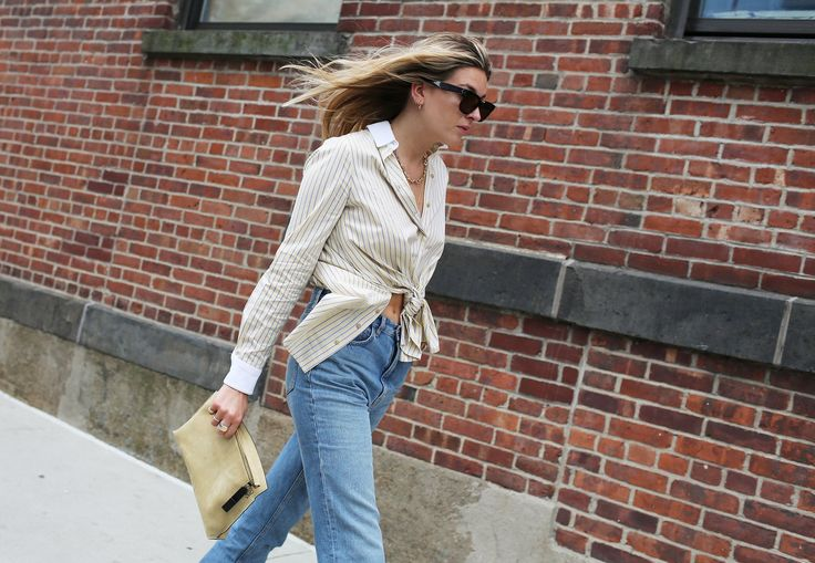 Camille Charrière in a Rosetta Getty shirt, Levi's jeans and with a a Loewe bag: