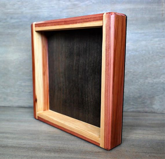 Red Cedar Wood Frame with Ebony Wood Stain Finish Background Measurements: •8 x 8 •9.5x 9.5 exterior width •1 to 2 depth available Item Features: •Ebony (black) Wood Stain Finish on background - no stain finish on the cedar wood. •Item is finely sanded to ensure a smooth and