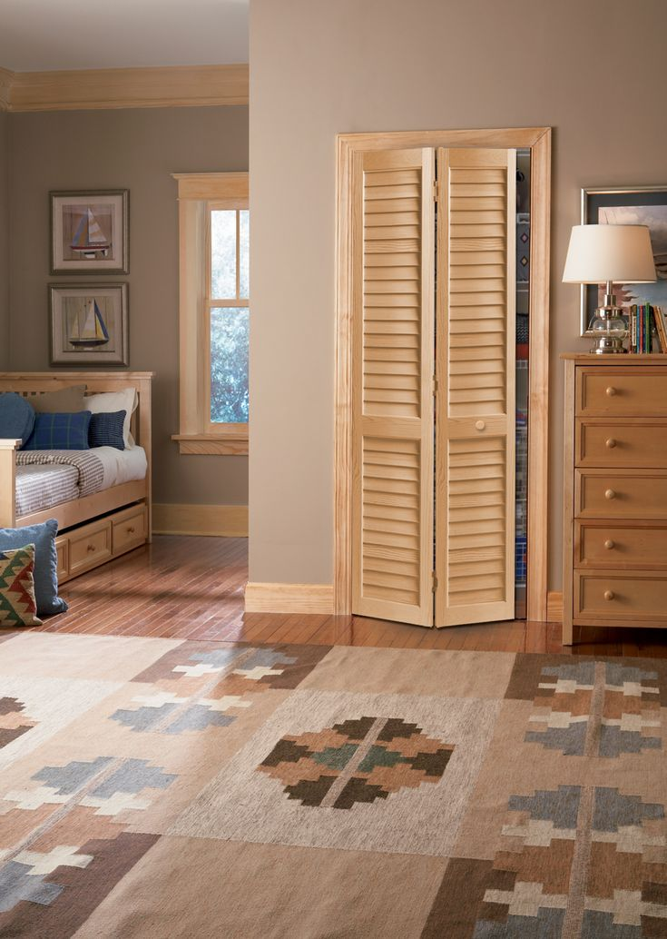 Southwestern style bedroom with a BiFold Louvered closet