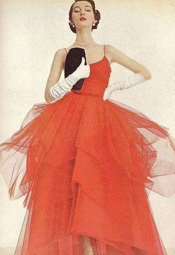 Dovima wearing a red silk and tulle evening gown, Vogue 1950