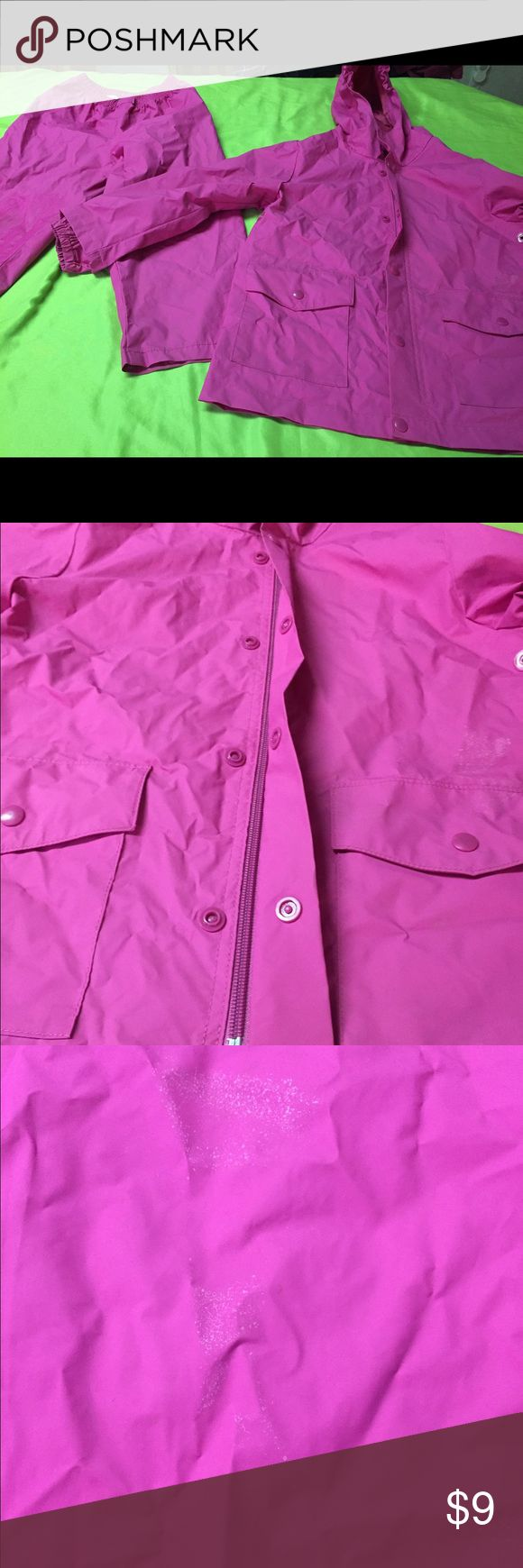 Girls rain suit. Size 5/6 jacket and pants. Girls hot pink full rain suit. There are NO rips or tears. There are though a slight stain on knees and a white speckled like stain on back (don't know what she got into?). These issues do NOT deter from the function though. Pro Rainer Jackets & Coats Raincoats