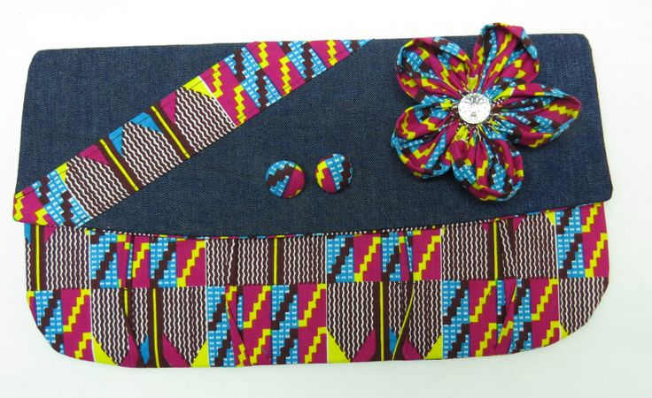 African print with denim clutch with button earrings and brooch.