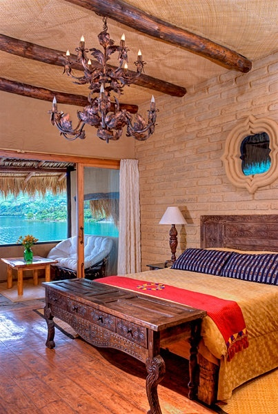 Laguna Lodge Eco-Resort & Nature Reserve in Guatemala. The pictured Quetzal Suite has views of Lake Atitlan and volcanoes.