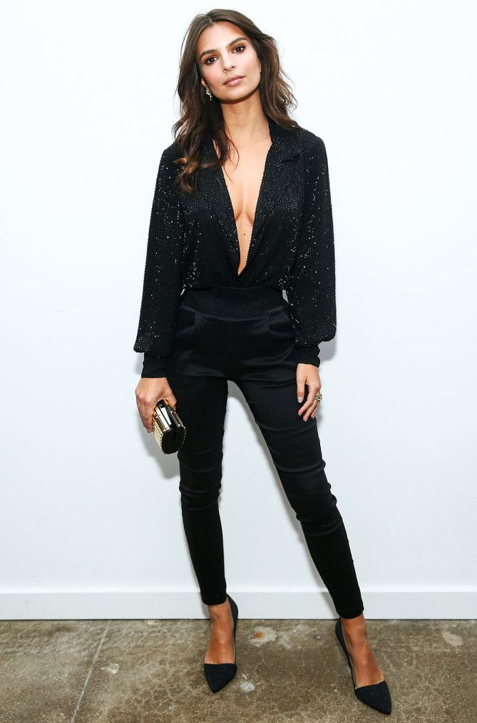 Emily Ratajkowski in a plunging black sparkly top and skinny pants