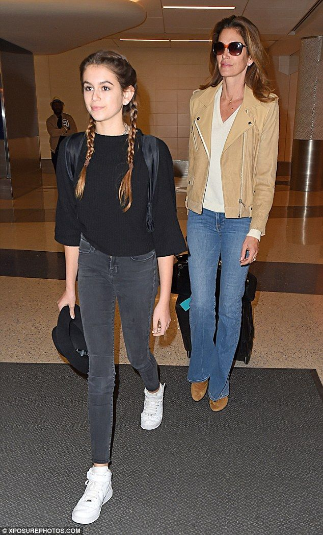 California cool: Cindy Crawford and her daughter Kaia, 14, were spotted returning to Los Angeles on Sunday
