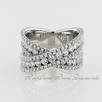 There are 133 = 2.40ct GH/VS – SI round brilliant cut diamonds channel and pavé set in 18k white gold