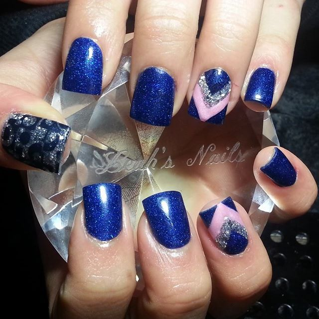 Royall blue full nails with silver thumb and chevron ring finger.