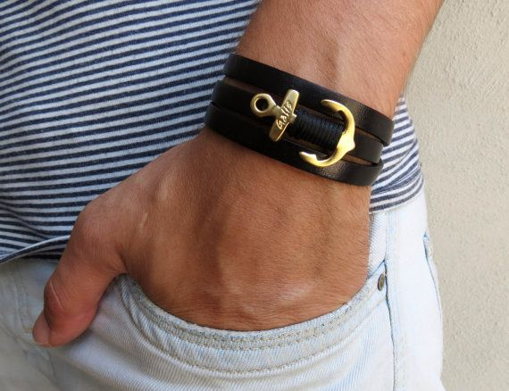 "Men's Bracelet - Men's Anchor Bracelet - Men's Leather Bracelet - Men's Black Bracelet - Mens Jewelry - Jewelry For Men - Gift for Him Looking for a gift for your man? You've found the perfect item for this! The simple and beautiful bracelet combines black leather which wrap 3 times on hand and a gold plated anchor pendant with a black wire wrapped on it. Lengh: 20.8"" (53 cm) + 2"" (5 cm) extension chain. Pendant Size: 1.3"" (3 cm) $34"