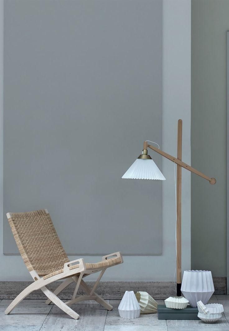 The classic Folding Chair by Hans J. Wegner and a beautiful floor lamp from Le Klint by Wilhelm Wohlert.
