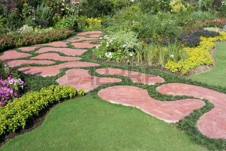 Lush blooming garden with paved path  Stock Photo