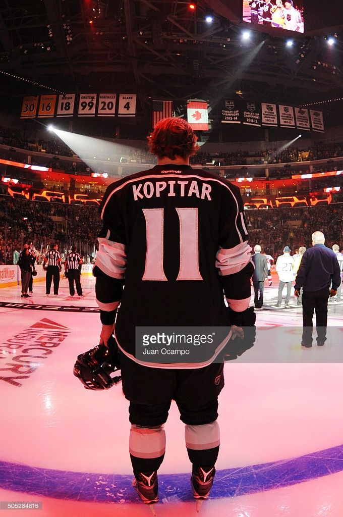 The 80 Million Dollar Man. Anze Kopitar #11 of the Los Angeles Kings listens to the Canadian national anthem prior to the game against the Ottawa Senators on January 16, 2016 at Staples Center in Los Angeles, California.