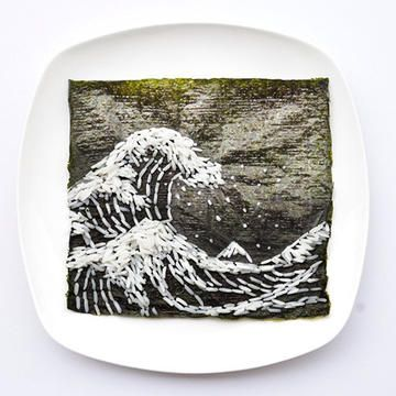 """Day seven sees an homage to the great artist, Hokusai Katsushika. Hong Yi's adaptation of """"The Great Wave off Kanagawa"""" is made of seaweed paper and rice. She points out """"That's Mt Fuji in the background!"""""""