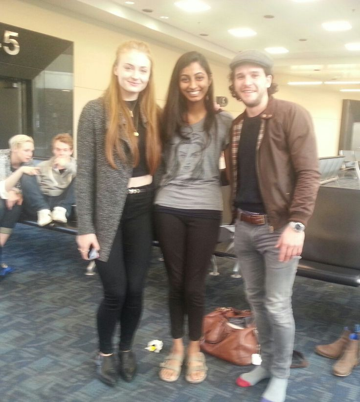 Sophie Turner and Kit Harrington pose with a fan at an ...