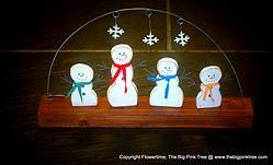 4 Wooden Snowmen.