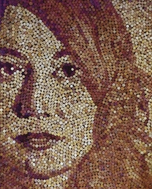 Using items and colour to create one big image, this image has been made out of corks.