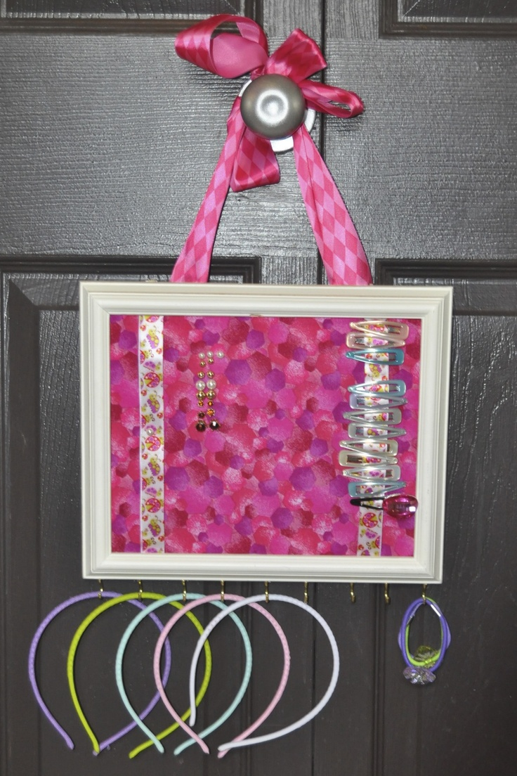 So I made this by combining different pinterest ideas.  I took a 8x10 frame and removed the glass, cut cross stitch mesh to fit and covered it with fabric and glued.  I then added 2 ribbons loosely on each side for barretts and put  cup hooks in the bottom for headbands and necklaces.  I then attached a larger ribbon on the back to use as a hangerCreative Organic, Crosses Stitches, Crafts Diy, Pinterest Ideas, Cross Stitches, Cut Crosses, Cups Hooks, 8X10 Frames