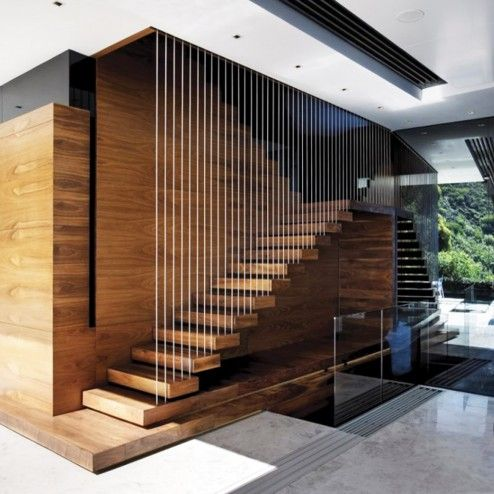 Interior Design, Awesome Bright Luxury Living Room Interior Design With Cool Wall Mounted Or Floating Wooden Staircase With Small Metal Bars Strips Railing Attached On Gloss Wood Covering Wall Decoration Ideas ~ Attractive Stair Designs Interior with Unique Architecture Design