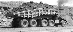 EUCLID.This is The Western Contracting 80.This is a modified Euclid  1LLD hauler.This trailer can haul 300,000 lbs or 150 tons.This started out with 2 Cummins diesels @ 750hp and was later upgraded to 850 with 2 Detroit Diesel 12V-71s