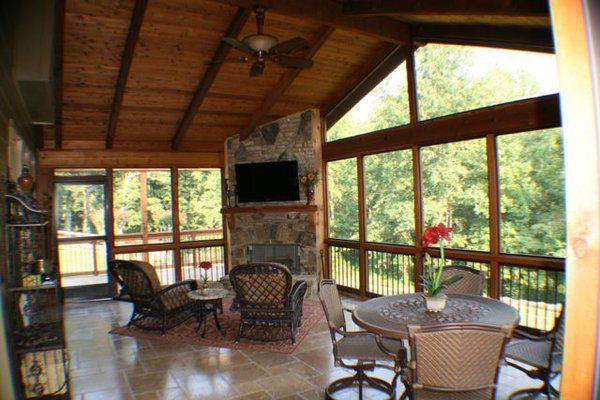 Porch with a fireplace and tv screened porch with for Wood burning stove for screened porch