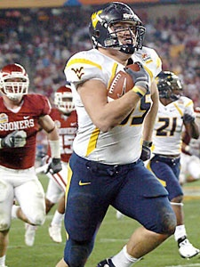 Owen Schmitt runs 57 yards for a touchdown in the 2008 Tostitos Fiesta Bowl. WVU beat No. 3-rated Oklahoma 48-28.