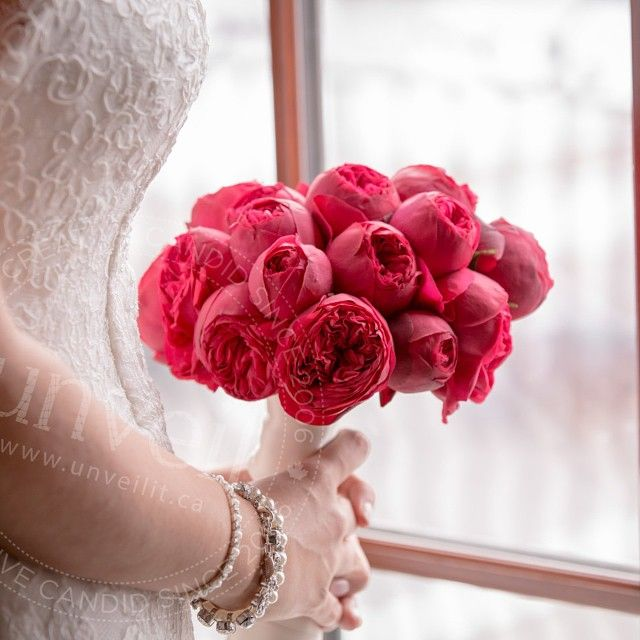 A red bouquet; the perfect fit for a snowy winter wedding.