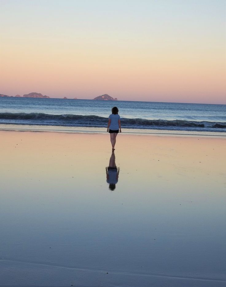Sunset at the beach. Reflection in the sand. By Christy-Lynn Breetvelt