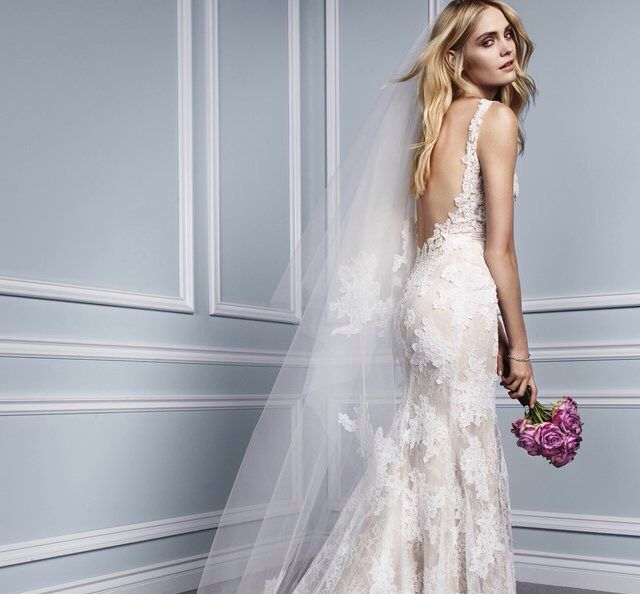 Monique Lhuillier Calla - Chantilly and re-embroidered lace V -neck sheath with low back Calla gown available at Julian Gold Bridal