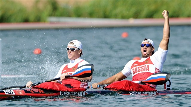 Yury Postrigay and Alexander Dyachenko of Russia celebrate winning the gold medal in the men's Kayak Double (K2) 200m Canoe Sprint on Day 15.