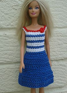 I've improvised my crochet dress pattern to make this blue and white crochet dress for Barbie. The pattern uses 4ply yarn - I used Patons 4ply soft cotton, but any 4ply would work. The bodice is made first in dc, from the waist to neckline, then the skirt is added from the waist to the hem. The pattern is very easy, worked in continuous rounds and all you need to know is how to do double crochet, treble crochet and slip stitch.