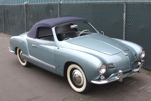 Karmann Ghia, 1959.  Only the second year of production.  Note the slightly different grills, as compared to the 1960 - 1974 grills.  I've seen one of these early Ghias only once, in a VW graveyard.  :(