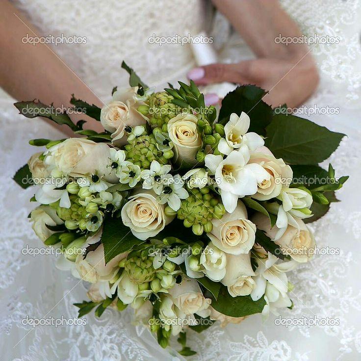 Elegant Bridal Bouquet Showcasing: Cream Roses, White Freesia, Star Of Bethlehem (Arabian Star Flower), Greenery + Green Foliage
