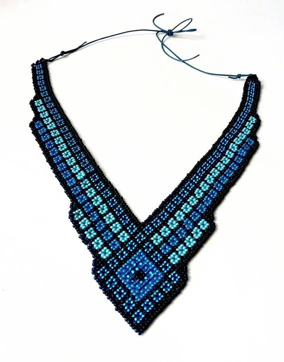 This beautiful beaded bib necklace has a mixture of consecutive colors and bright focal point in the center. - Creatured for use on all occasions; At the office, a night or just hanging out. Combine this piece with your other favorite jewelery. - Try a dark blouse, top or dress and