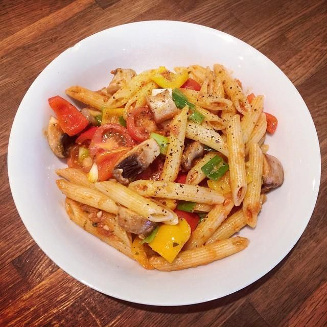 Red pesto pasta with mushrooms, red and yellow peppers, spring onions and tomatoes. Simple but oh so tasty.