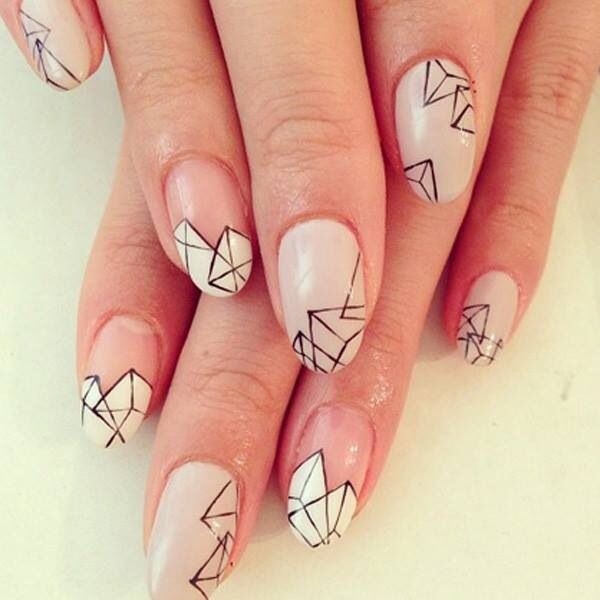 Great use of negative space on this geometric nail design!