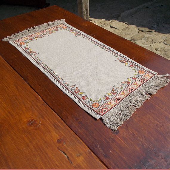 Hand embroidered table runner, table topper with Bulgarian motifs. Discover this decorative and beautiful handmade linen table runner from our