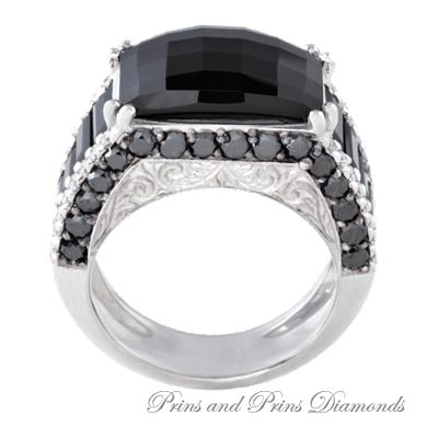 Centre black diamond with onyx set in sides and top of shank in an 18k white gold setting